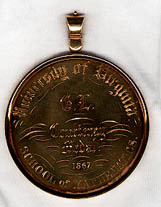 "Courtenay Gold Medal. School of Mathematics. 1867. Inscribed on the verso, ""Omnia in mensura, et numero et pondere."""