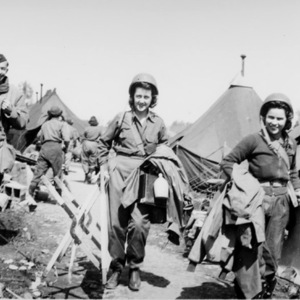 Photograph of nurses packing up to move. 1944-45.