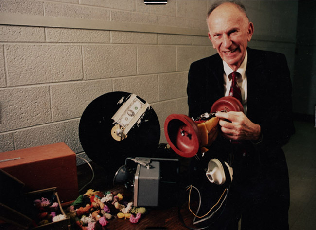 Photograph of Raymond C. Bice with pseudophone. No date.