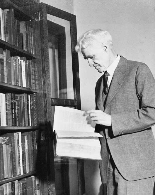 Tracy W. McGregor examining one of his books, ca. 1932.