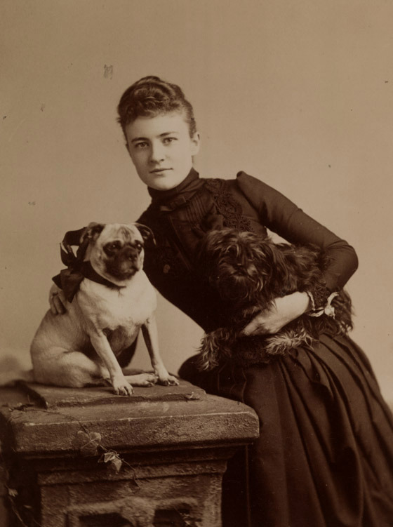 Lillian Marie Gary with her dogs, ca. 1888. Gift of Mrs. R. C. Taylor (MSS 5231-f)