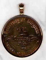 "Courtenay Gold Medal. School of Mathematics. 1867. Inscribed on the verso, ""Omnia in mensura, et numero et pondere."""