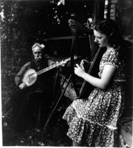 """""""Banjo and Harp."""" Photograph published in """"Folk Singers."""""""