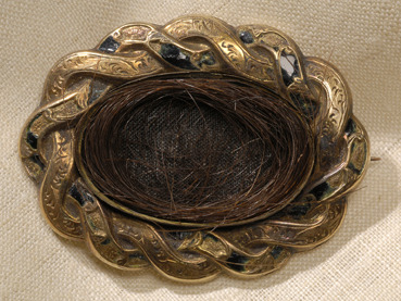 Brooch with a lock of Poe's hair