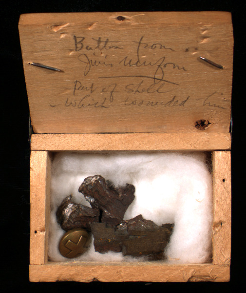 McConnell artifacts. Shrapnel and button