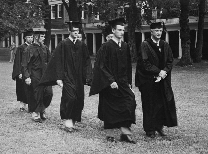 "Photograph. President Colgate Darden ""walking the Lawn"" at graduation with the officers of the graduating Class of 1954. Photograph by Ralph Thompson."