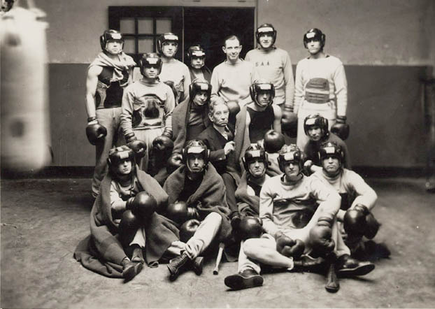 Photograph of Johnny LaRowe with boxing team.