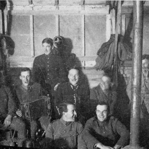 McConnell photographs. Members of the Lafayette Escadrille at a party; McConnell is front row, center