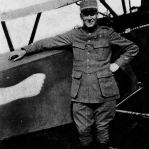 McConnell photographs. With his airplane (emblem of the Hotfoot Society on the fuselage)