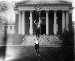 University gymnastics team in front of Fayerweather Gymnasium