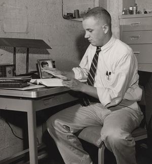A student in a McCormick Road dormitory room, ca. 1952